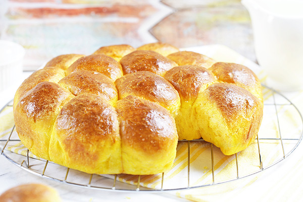 Sweet Potato Dinner Rolls - easy dinner rolls made from scratch from start to finish in 1-hour! Sweet potato gives them a nice yellow color and keeps them soft the next day.