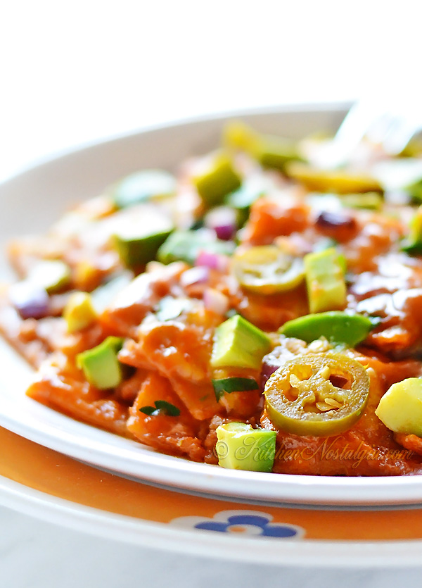 Chilaquiles - fried tortilla wedges in spicy enchilada sauce topped ...