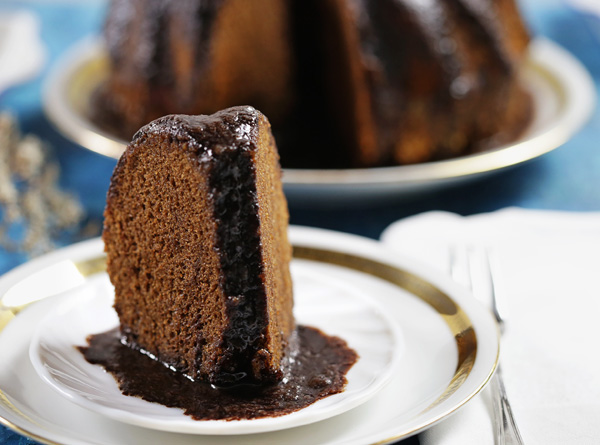 Chocolate Rum Cake - dense cake with a fine grain and moist texture, soaked with hot rum butter sauce. Yum!