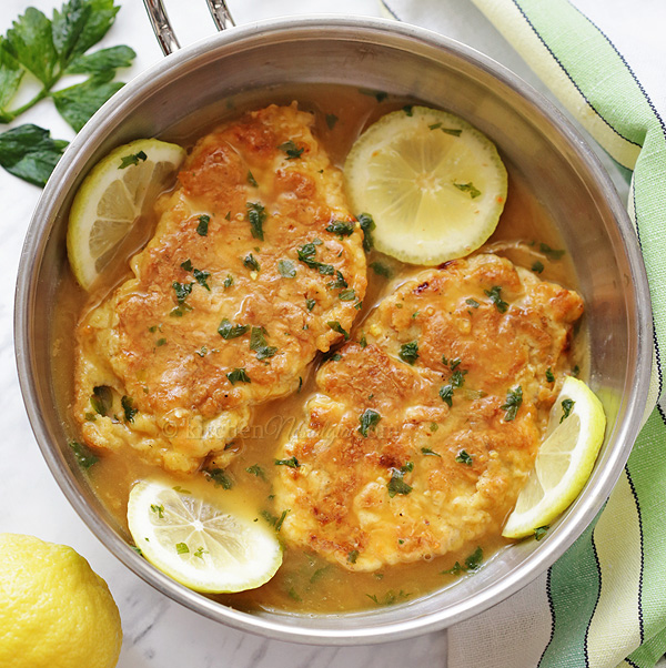 Chicken Francese - Italian-American one pan dish of breaded chicken cutlets simmered in a lemon, white wine and butter sauce